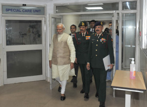 The Prime Minister, Shri Narendra Modi visits Siachen survivor Lance Naik Hanumanthappa at Army's Research & Referral Hospital, in New Delhi on February 09, 2016.
